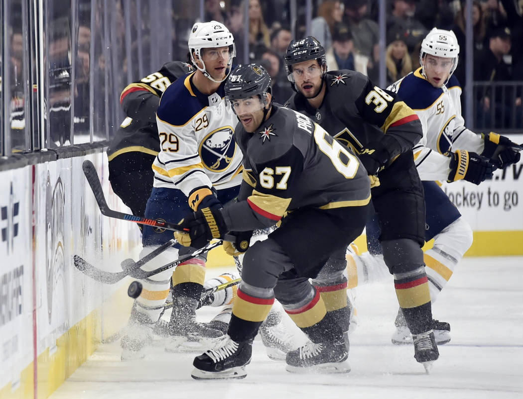 Vegas Golden Knights left wing Max Pacioretty (67) and left wing Tomas Hyka (38) skate for the puck against Buffalo Sabres right wing Jason Pominville (29) and defenseman Rasmus Ristolainen (55) d ...