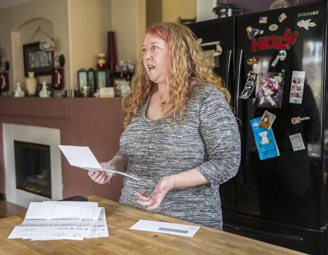 Diane Parnell discusses issues related to a medical bill she received after her son Brandon's recent visit to an emergency room on Wednesday, Aug. 29, 2018, at Parnell's home, in Henderson. Benjam ...