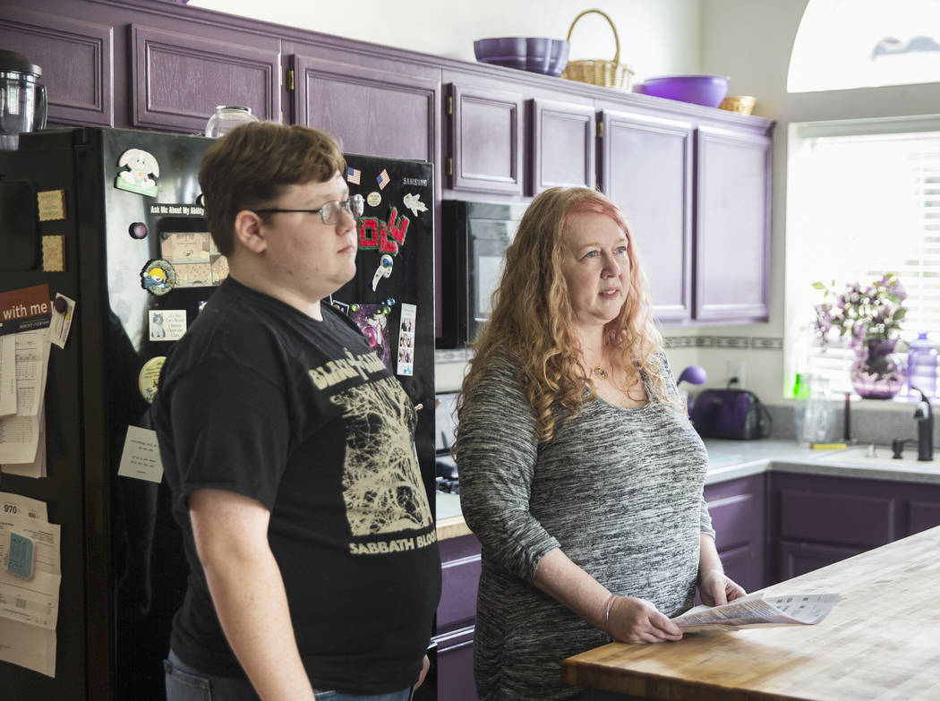 Diane Parnell, right, and son Brandon, 15, discuss issues related to a medical bill they received after a recent visit to an emergency room on Wednesday, Aug. 29, 2018, at Parnell's home, in Hende ...