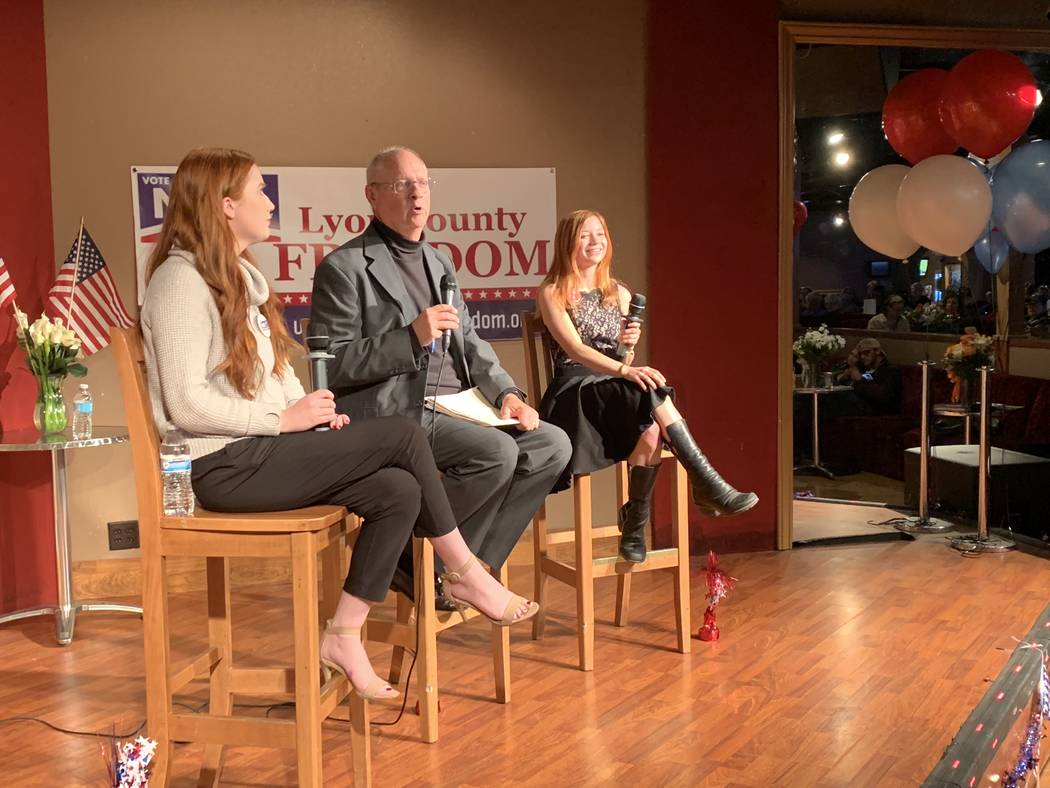 "Chuck Muth, center, moderated a Q&A Thursday night in Mound House, Lyon County, with two legal sex workers on a possible move to ban legal prostitution in the county. ""Ruby Rae,"" left, and ""Alice ..."