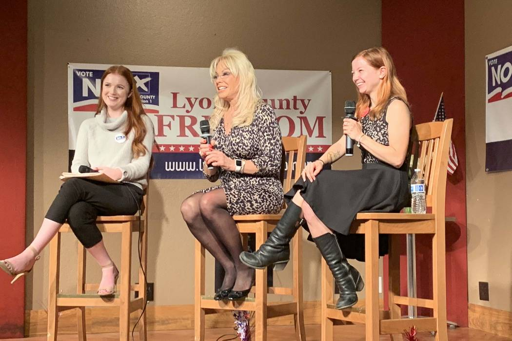 """Air Force Amy,"" center, a legal sex worker, talks about brothel owner Dennis Hof at a Q&A Thursday night in Mound House, Lyon County, on a possible move to ban legal prostitution in the county. S ..."