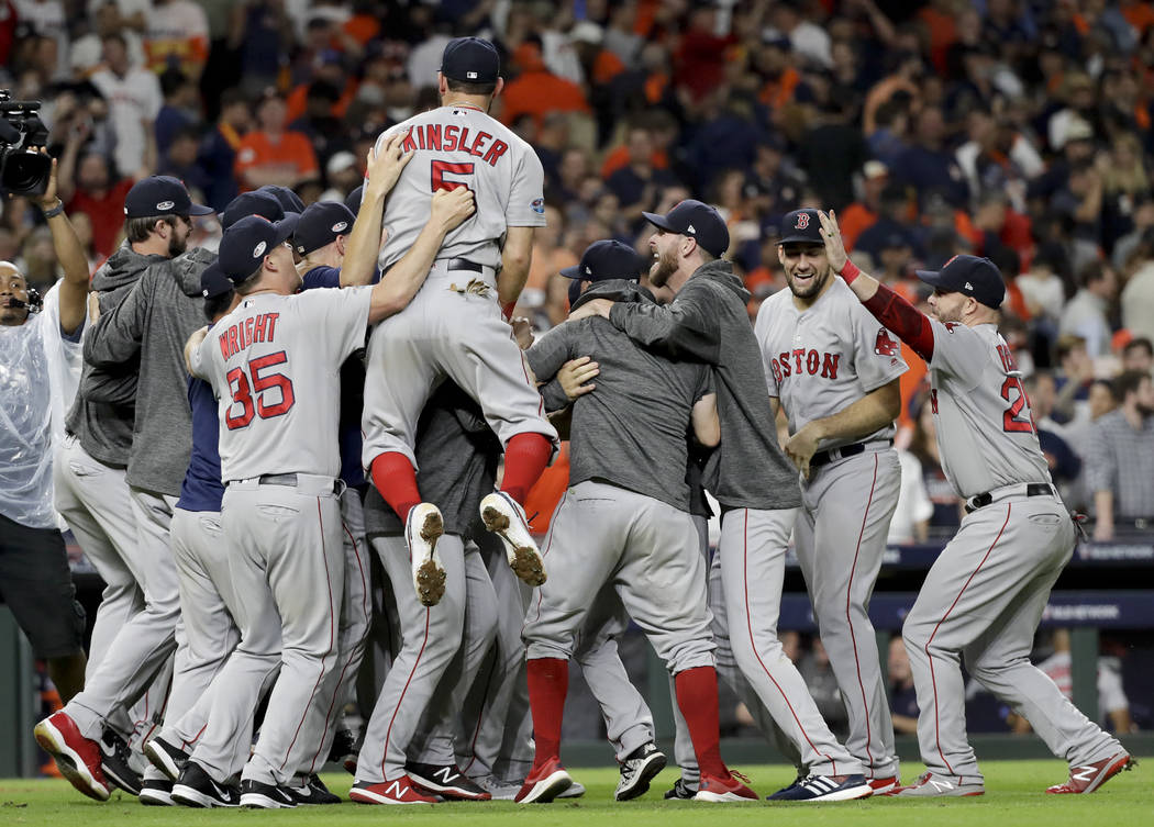 The Boston Red Sox celebrates after winning Game 5 of a baseball American League Championship Series against the Houston Astros on Thursday, Oct. 18, 2018, in Houston. (AP Photo/David J. Phillip)