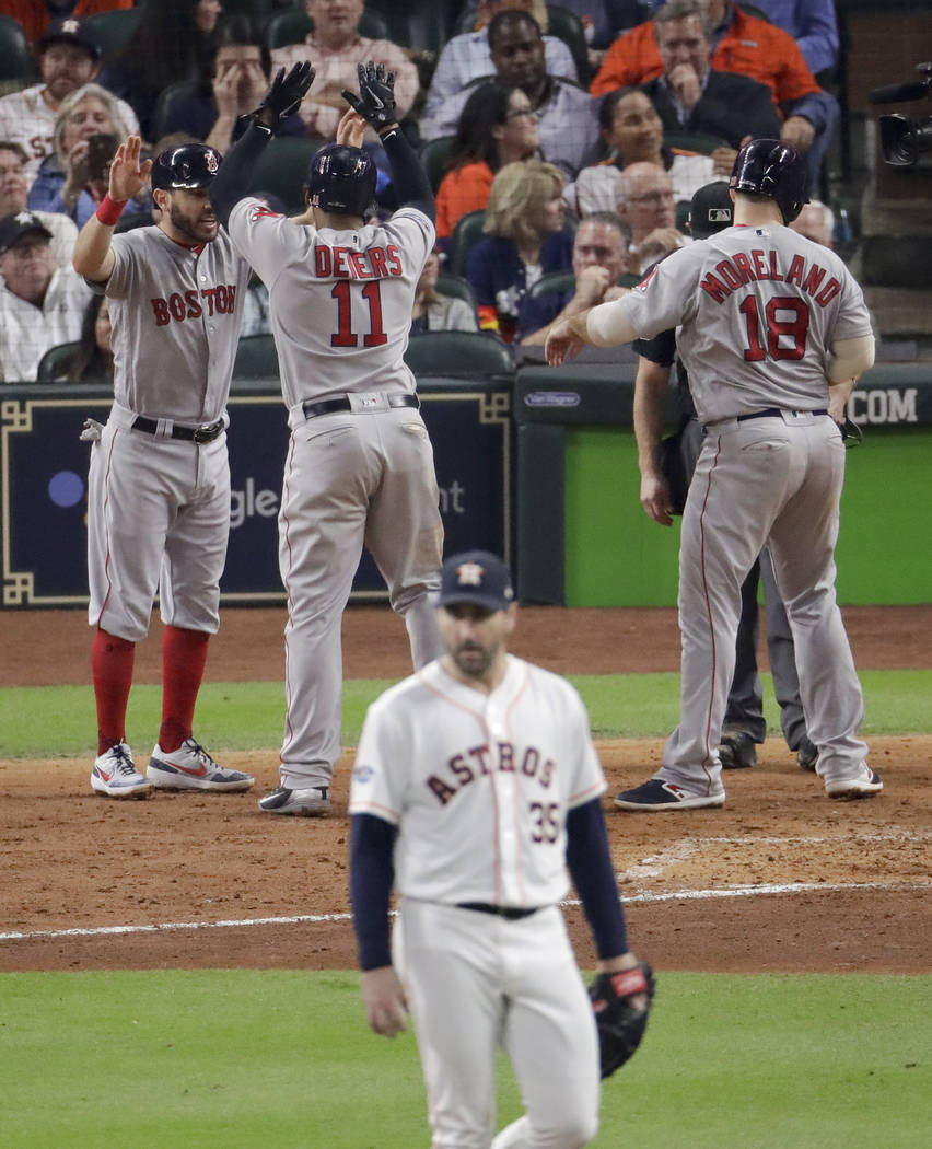 Boston Red Sox's Rafael Devers celebrates his three-run home run off Houston Astros starting pitcher Justin Verlander during the sixth inning in Game 5 of a baseball American League Championship S ...