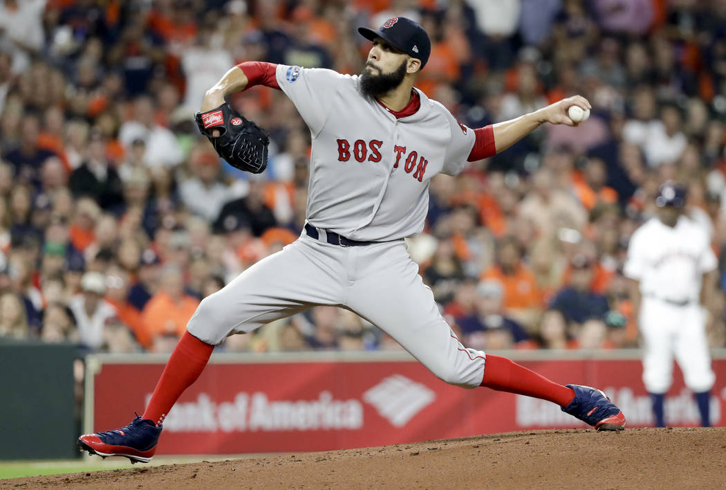 Boston Red Sox starting pitcher David Price throws against the Houston Astros during the first inning in Game 5 of a baseball American League Championship Series on Thursday, Oct. 18, 2018, in Hou ...