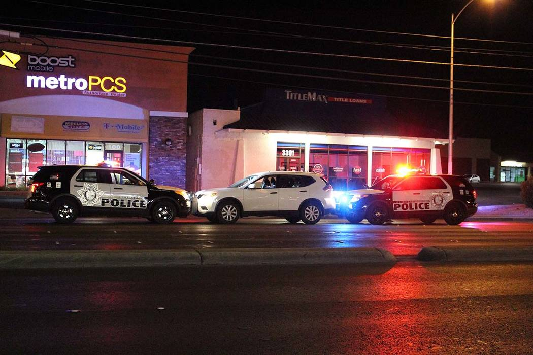 Police block a white SUV after finding the driver passed out at the wheel Friday, Oct. 19, 2018, on Tropicana Avenue at Pecos Road. (Max Michor/Las Vegas Review-Journal)
