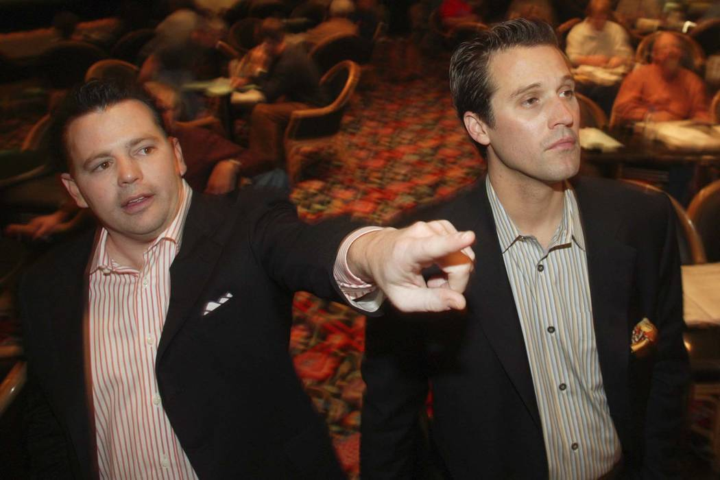 Golden Nugget owners Tim Poster, left, and Tom Breitling check out the line at the Golden Nugget Sportsbook on Jan. 23, 2004. It was the first day of ownership for the two at the downtown property ...