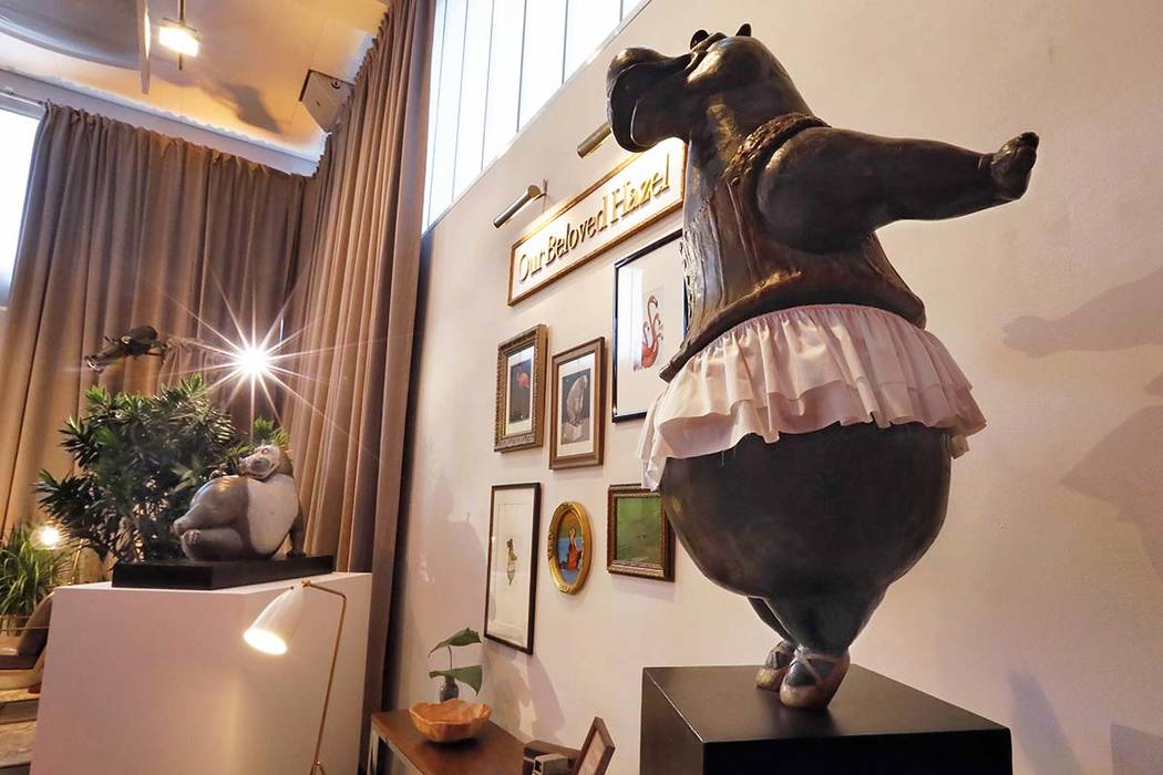 A bronze hippo by Danish sculptor Bjorn Okholm Skaarup appears during a preview of the Neiman Marcus Christmas Book in New York, Thursday, Oct. 18, 2018. Skaarup can cast a family pet or favorite ...