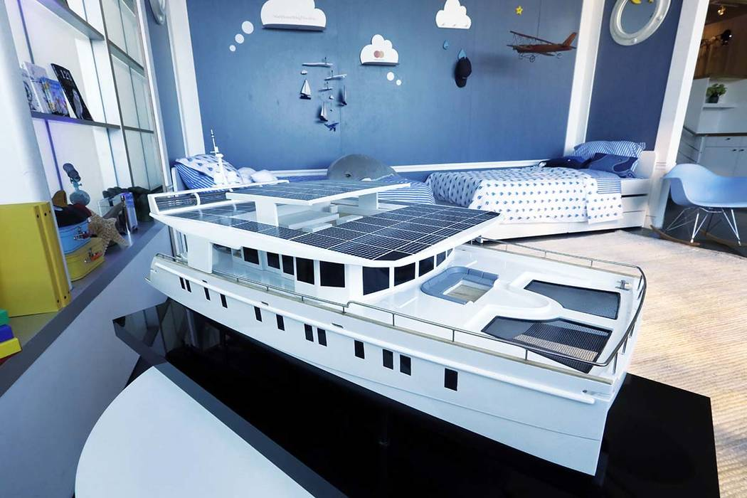 A model of the 74-foot Neiman Marcus Serenity Solar Yacht is displayed during a preview of the Neiman Marcus Christmas Book in New York, Thursday, Oct. 18, 2018. The solar-driven yacht that comfor ...