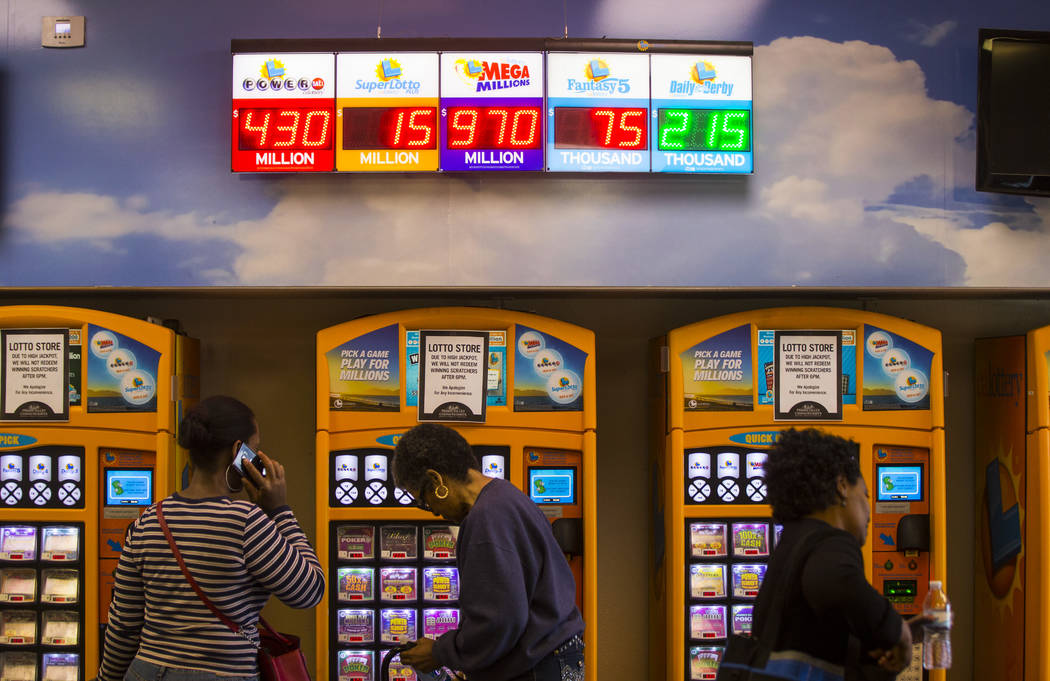 Lottery jackpots are digitally displayed at the Primm Valley Lotto Store as people wait to buy the Mega Millions lottery tickets in Primm on Thursday, Oct. 18, 2018. Chase Stevens Las Vegas Review ...