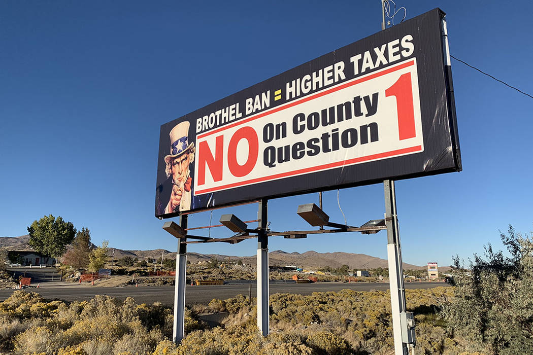 A sign outside the Bunny Ranch restaurant in Mound House, Lyon County, urges people to vote against banning legal prostitution in the county. (Bill Dentzer/Las Vegas Review-Journal)