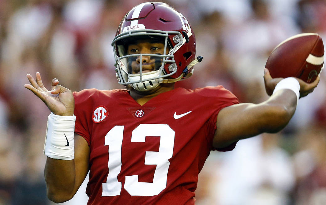 FILE - In this Oct. 13, 2018, file photo, Alabama quarterback Tua Tagovailoa (13) throws a pass during the first half of the team's NCAA college football game against Missouri in Tuscaloosa, Ala. ...