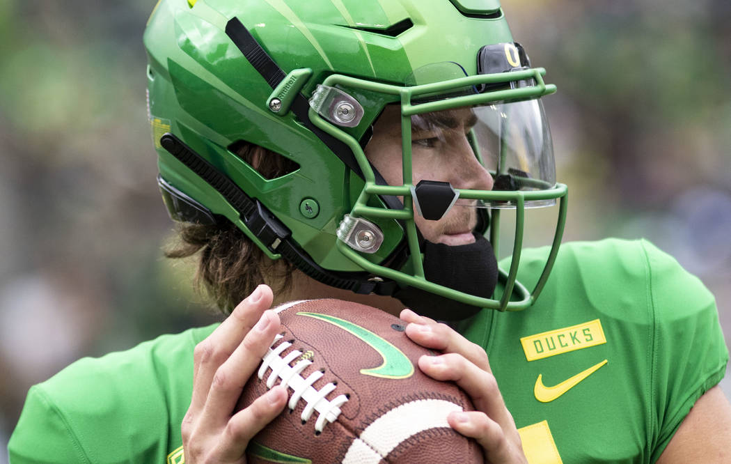 FILE - In this Saturday, Sept. 8, 2018, file photo, Oregon quarterback Justin Herbert went 20-of-26 with 250 yards, four touchdowns and no picks in their 62-14 win against Portland State during an ...