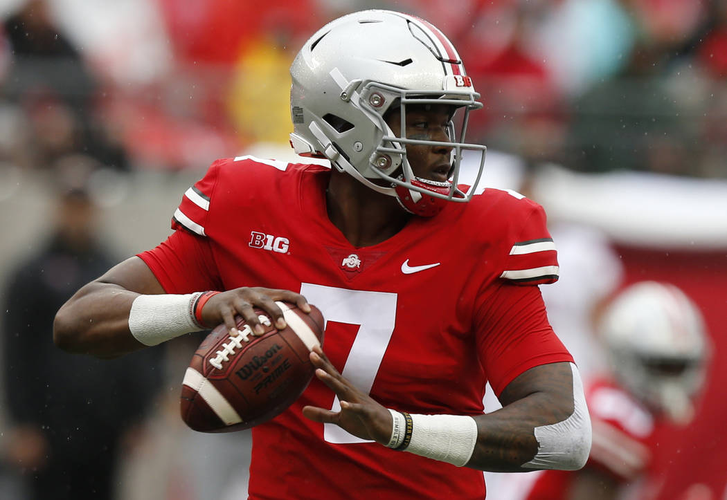In this Sept. 8, 2018 photo Ohio State quarterback Dwayne Haskins plays against Rutgers during an NCAA college football game in Columbus, Ohio. The front-runners have clearly been established in t ...