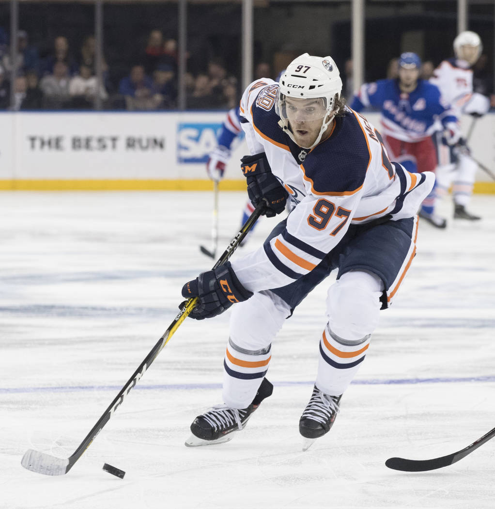a0c6acf2712 Edmonton Oilers center Connor McDavid controls the puck during the third  period of an NHL hockey