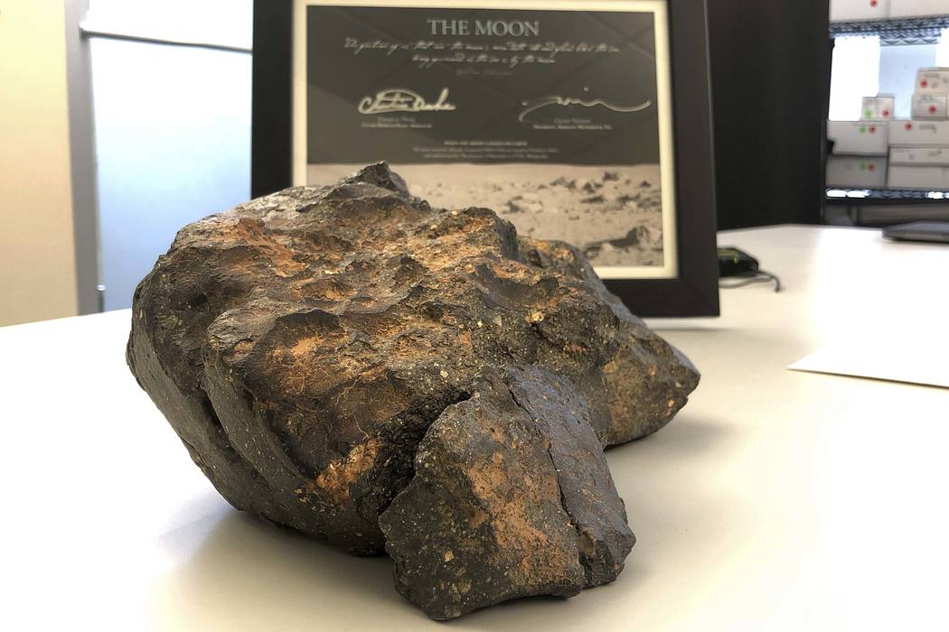 A 12-pound (5.5 kilogram) lunar meteorite discovered in Northwest Africa in 2017 rests on a table, in Amherst, N.H. The lunar meteorite has been sold at auction for more than $600,000. (AP Photo/ ...