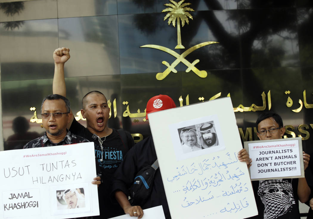 A dozen of Indonesian journalists hold posters with photos of Saudi writer Jamal Khashoggi during a protest outside Saudi Arabian Embassy in Jakarta, Indonesia, Friday, Oct. 19, 2018. A Turkish of ...