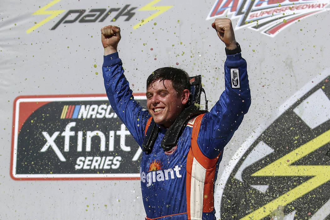 Spencer Gallagher (23) celebrates after winning the NASCAR Xfinity Series pauto race at Talladega Superspeedway, Saturday, April 28, 2018, in Talladega, Ala. (AP Photo/Butch Dill)