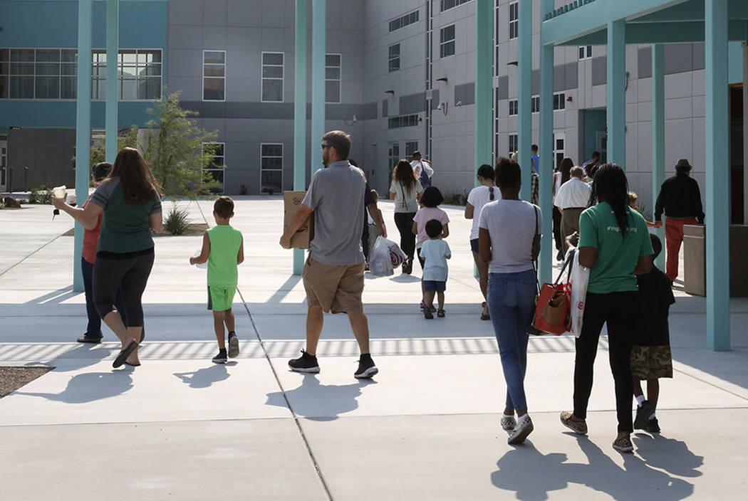 Parents and new students enter the new Robert and Sandy Ellis Elementary School at 3200 Artella Ave., on Friday, Aug. 10, 2018, in Henderson. Bizuayehu Tesfaye/Las Vegas Review-Journal @bizutesfaye