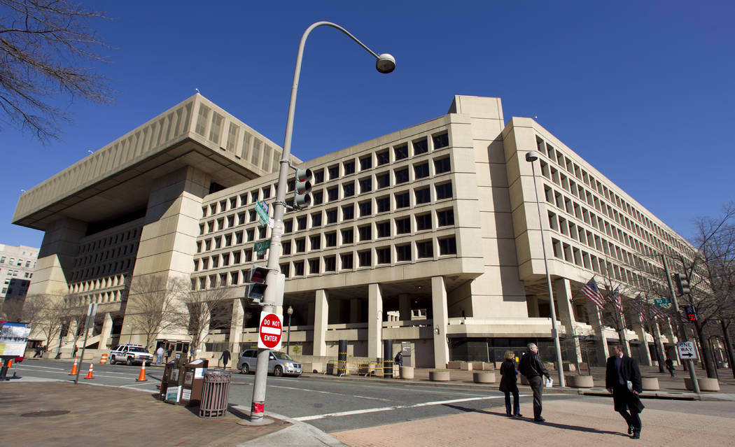 FILE - This Feb. 3, 2012, file photo shows FBI headquarters in Washington. Congressional Democrats say they have evidence that President Donald Trump personally directed subordinates to scrap a l ...