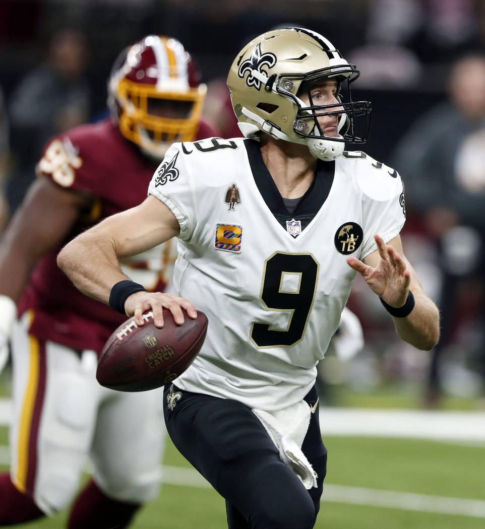 New Orleans Saints quarterback Drew Brees (9) scrambles in the first half of an NFL football game against the Washington Redskins in New Orleans, Monday, Oct. 8, 2018. (AP Photo/Gerald Herbert)