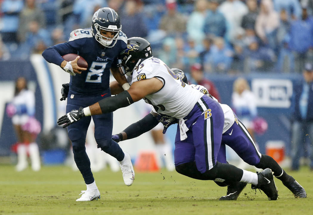 Tennessee Titans quarterback Marcus Mariota (8) is sacked by Baltimore Ravens defensive end Chris Wormley (93) for a 6-yard loss in the first half of an NFL football game Sunday, Oct. 14, 2018, in ...