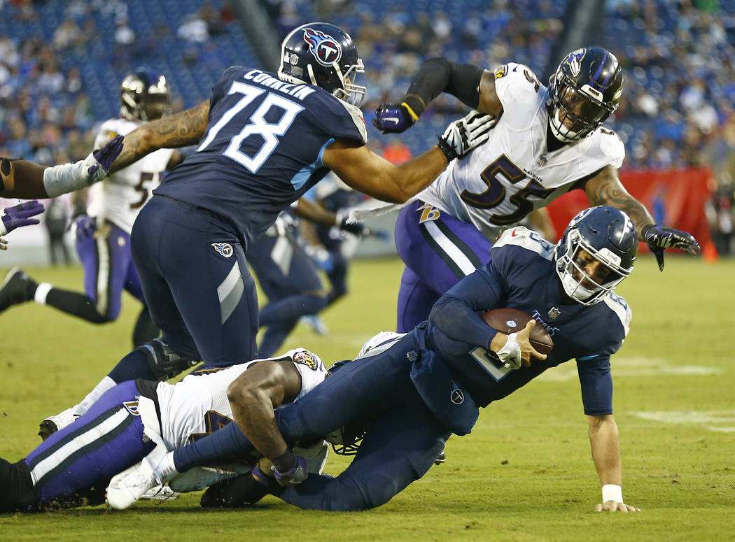 Tennessee Titans quarterback Marcus Mariota (8) is sacked by Baltimore Ravens linebacker Patrick Onwuasor for a 7-yard loss in the second half of an NFL football game Sunday, Oct. 14, 2018, in Nas ...