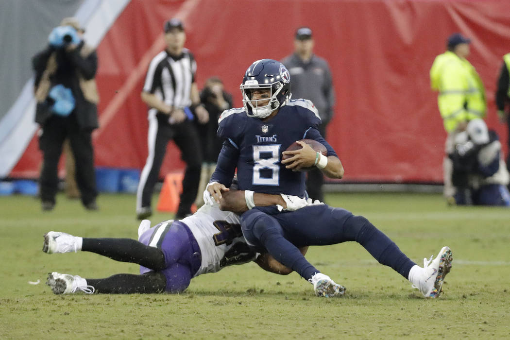 Tennessee Titans quarterback Marcus Mariota (8) is sacked for a 3-yard loss by Baltimore Ravens linebacker Kenny Young (40) in the second half of an NFL football game Sunday, Oct. 14, 2018, in Nas ...