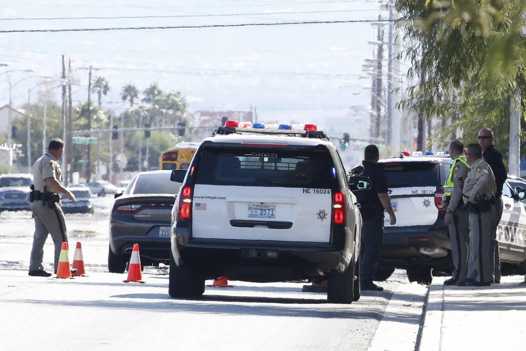 Las Vegas police investigate a crash involving an officer at North Nellis Boulevard and Geist Avenue on Thursday, Oct. 18 , 2018, in Las Vegas. (Bizuayehu Tesfaye/Las Vegas Review-Journal) @bizute ...