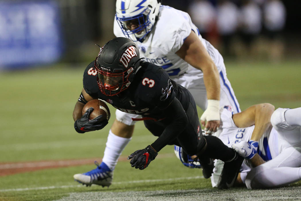 UNLV Rebels running back Lexington Thomas (3) is tackled after a run against Air Force Falcons in the second quarter of the football game at Sam Boyd Stadium in Las Vegas, Friday, Oct. 19, 2018. E ...