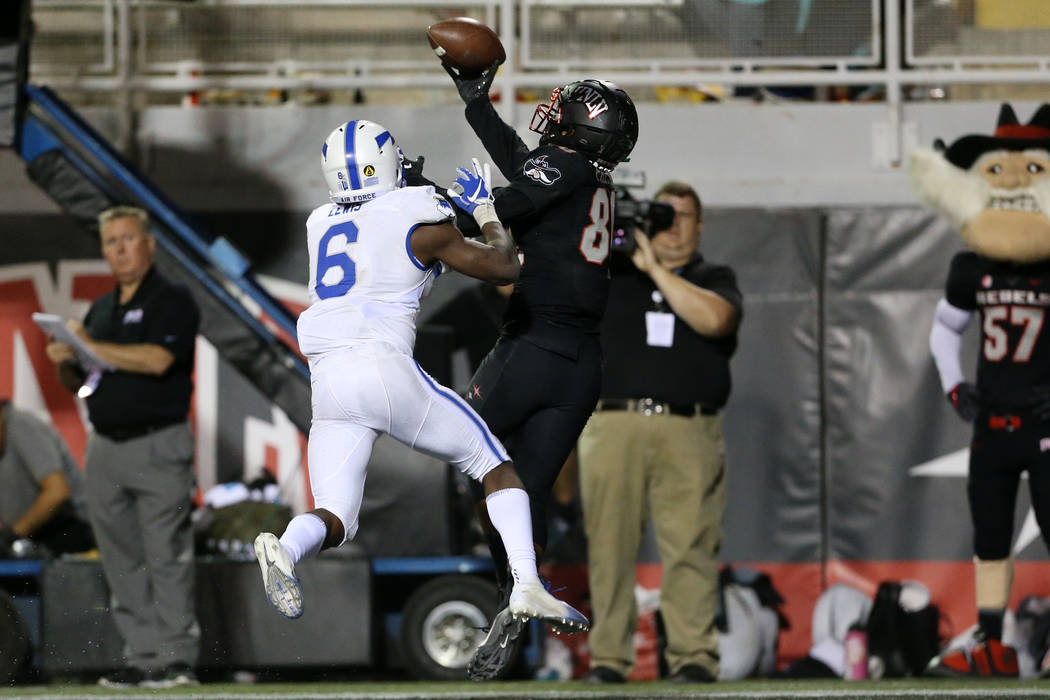 UNLV Rebels wide receiver Brandon Presley (80) makes a one hand catch with coverage from Air Force Falcons defensive back Zane Lewis (6) during the fourth quarter of the football game at Sam Boyd ...
