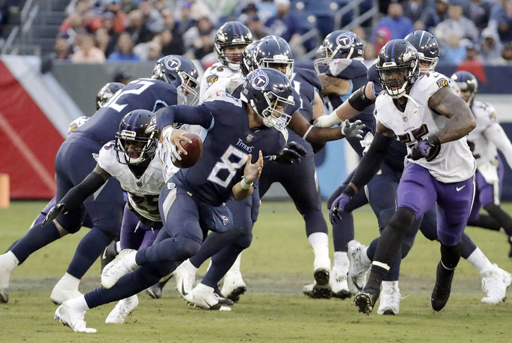 Tennessee Titans quarterback Marcus Mariota scrambles against the Baltimore Ravens in Nashville, Tenn., on Oct. 14, 2018. (AP Photo/James Kenney)