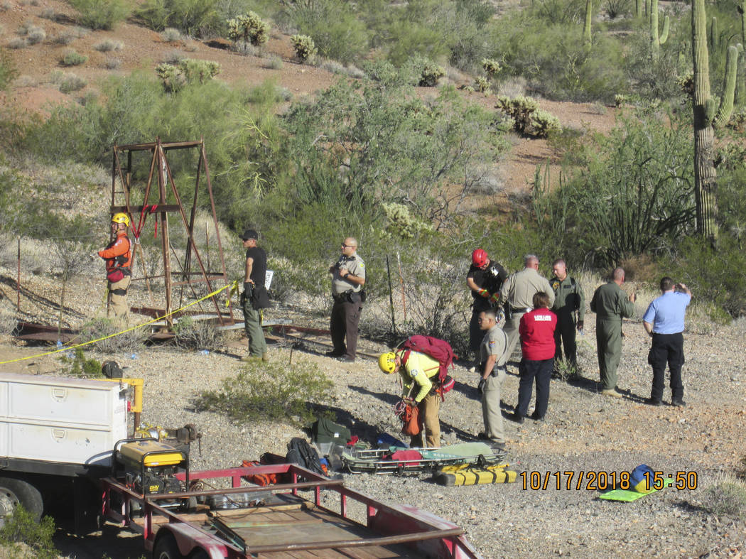 A rescue team gathers to rescue a man who fell into an old abandoned mine shaft near Aguila, Ariz. (Maricopa County Sheriff's Office via AP)