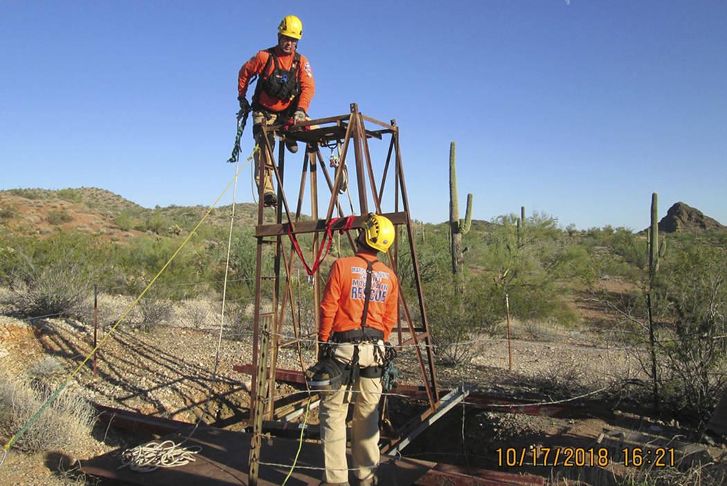 A Maricopa County Mountain Rescue team prepare to rescue a man who fell into an old abandoned mine shaft near Aguila, Ariz. (Maricopa County Sheriff's Office via AP)