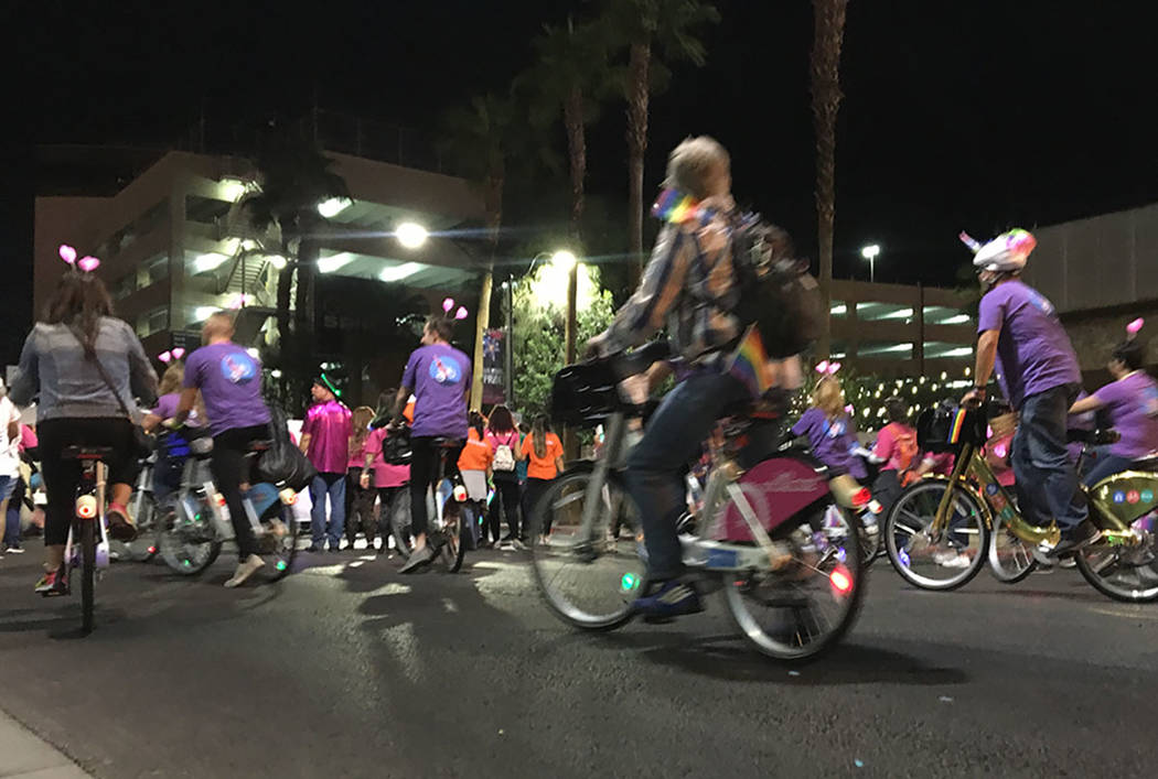 Bicyclists ride through downtown during the Las Vegas PRIDE Night Parade on Friday, Oct. 19, 2018. (Kimber Laux/Las Vegas Review-Journal)