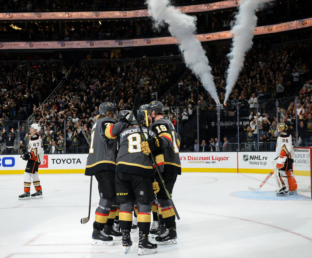 The Vegas Golden Knights celebrate after their first goal of the game during the first period of an NHL hockey game against the Anaheim Ducks at T-Mobile Arena in Las Vegas, Saturday, Oct. 20, 201 ...