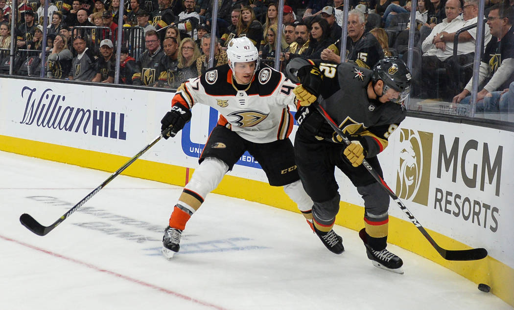 Anaheim Ducks defenseman Hampus Lindholm (47) defends against Vegas Golden Knights left wing Tomas Nosek (92) during the first period of an NHL hockey game at T-Mobile Arena in Las Vegas, Saturday ...