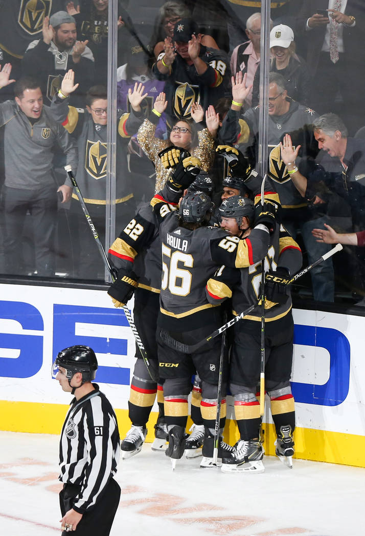 The Golden Knights celebrate a score by Vegas Golden Knights left wing Erik Haula (56) against the Anaheim Ducks during the second period of an NHL hockey game at T-Mobile Arena in Las Vegas, Satu ...