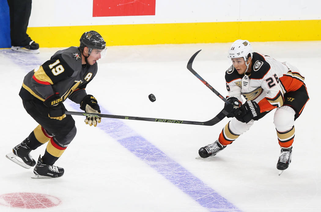 Vegas Golden Knights right wing Reilly Smith (19) fights for the puck against Anaheim Ducks defenseman Brandon Montour (26)) during the second period of an NHL hockey game at T-Mobile Arena in Las ...