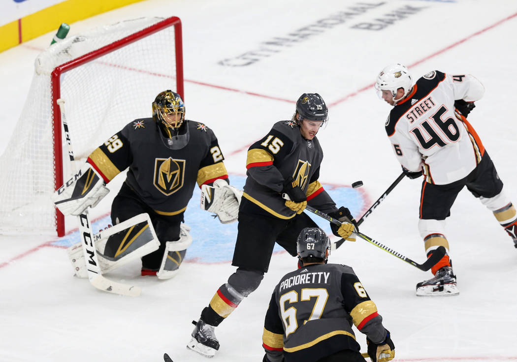 Vegas Golden Knights defenseman Jon Merrill (15) steals the puck from Anaheim Ducks center Ben Street (46) during the second period of an NHL hockey game at T-Mobile Arena in Las Vegas, Saturday, ...