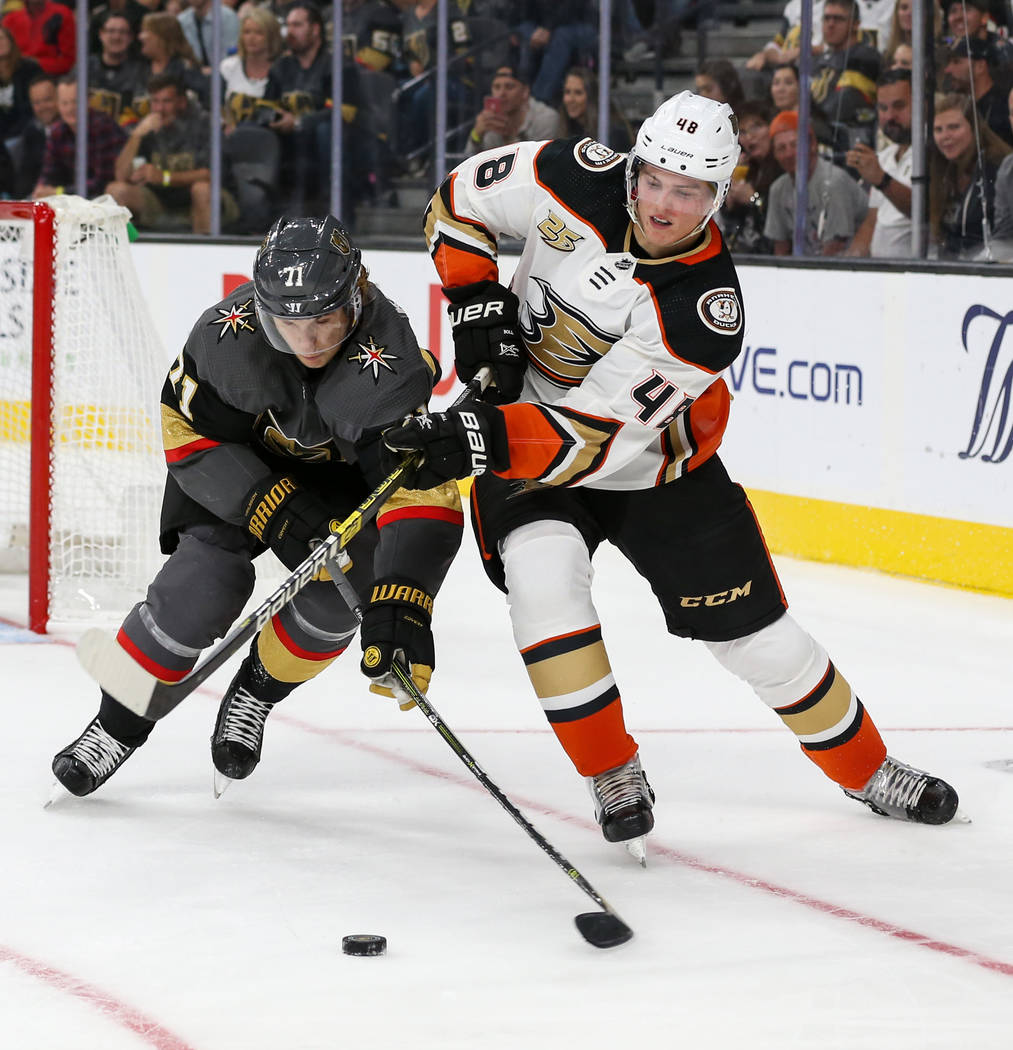 Vegas Golden Knights center William Karlsson (71) fights for the puck against Anaheim Ducks center Isac Lundestrom (48) during the third period of an NHL hockey game at T-Mobile Arena in Las Vegas ...