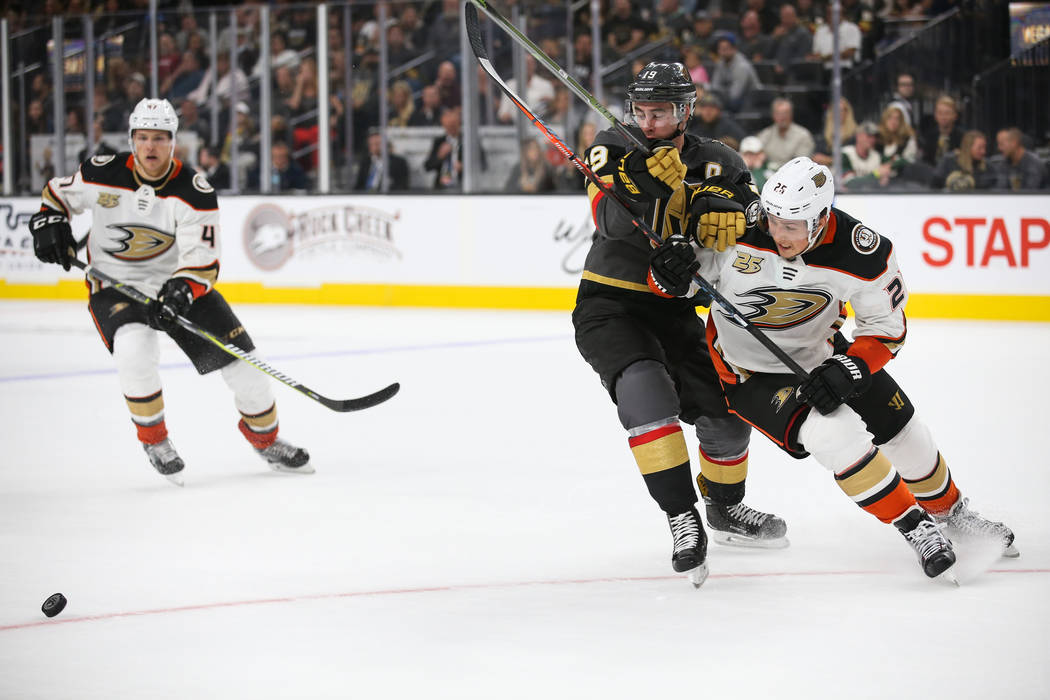 Vegas Golden Knights right wing Reilly Smith (19) blocks Anaheim Ducks right wing Ondrej Kase (25) from the puck during the third period of an NHL hockey game at T-Mobile Arena in Las Vegas, Satur ...