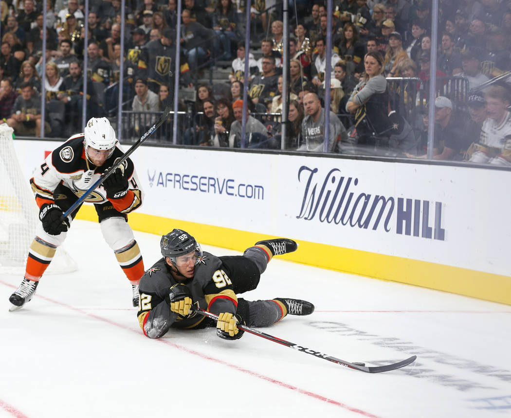 Vegas Golden Knights left wing Tomas Nosek (92) reaches for the puck as Anaheim Ducks defenseman Cam Fowler (4) watches during the third period of an NHL hockey game at T-Mobile Arena in Las Vegas ...