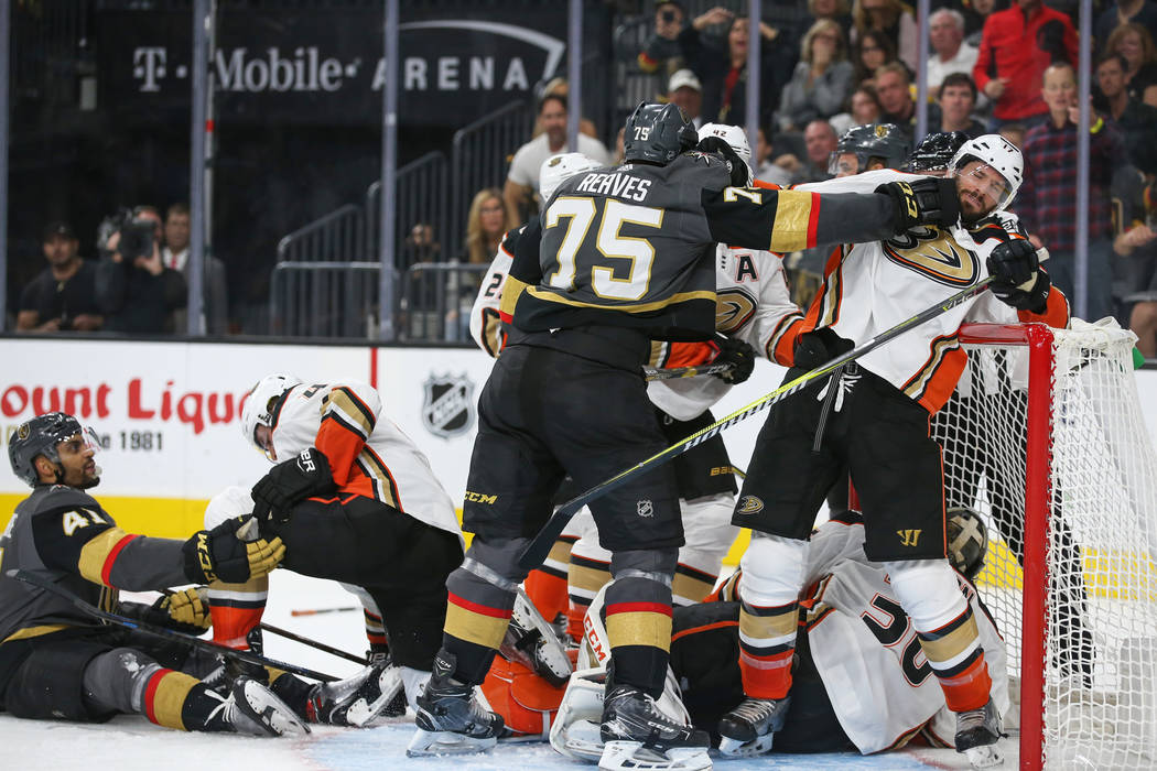 Vegas Golden Knights right wing Ryan Reaves (75) hits Anaheim Ducks center Ryan Kesler (17) during the third period of an NHL hockey game at T-Mobile Arena in Las Vegas, Saturday, Oct. 20, 2018. C ...