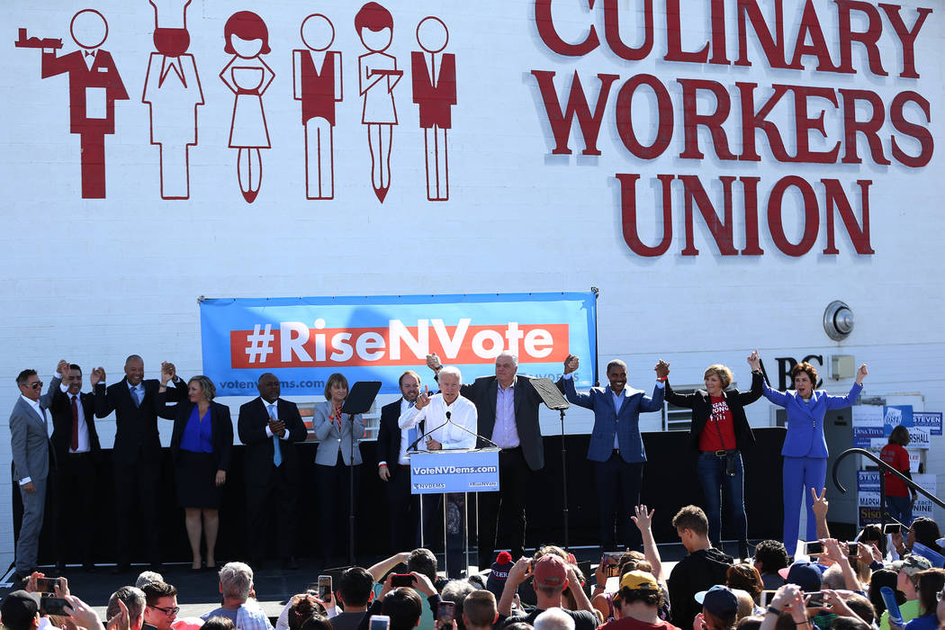 Former Vice President Joe Biden, center, with Nevada democratic candidates, rallies the crowd during a Nevada State Democratic Party rally to promote voting at the Culinary Workers Union Local 226 ...