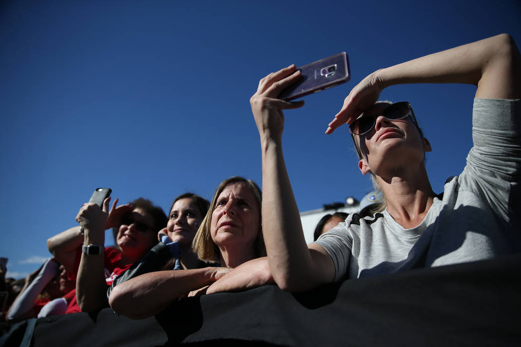 Attendees listen to former Vice President Joe Biden rally the crowd during a Nevada State Democratic Party rally to promote voting at the Culinary Workers Union Local 226 headquarters in Las Vegas ...