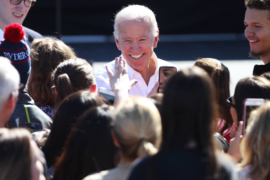 Former Vice President Joe Biden greets attendees during a Nevada State Democratic Party rally to promote voting at the Culinary Workers Union Local 226 headquarters in Las Vegas, Saturday, Oct. 20 ...
