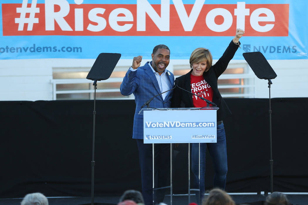 Democratic candidates for Congress Steven Horsford, left, and Susie Lee rally the crowd during a Nevada State Democratic Party rally to promote voting at the Culinary Workers Union Local 226 headq ...