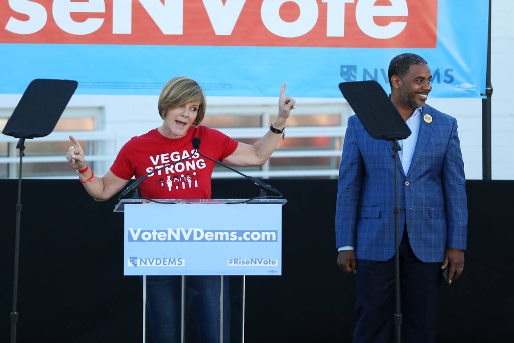 Democratic candidates for Congress Susie Lee, left, with Steven Horsford, speaks during a Nevada State Democratic Party rally to promote voting at the Culinary Workers Union Local 226 headquarters ...