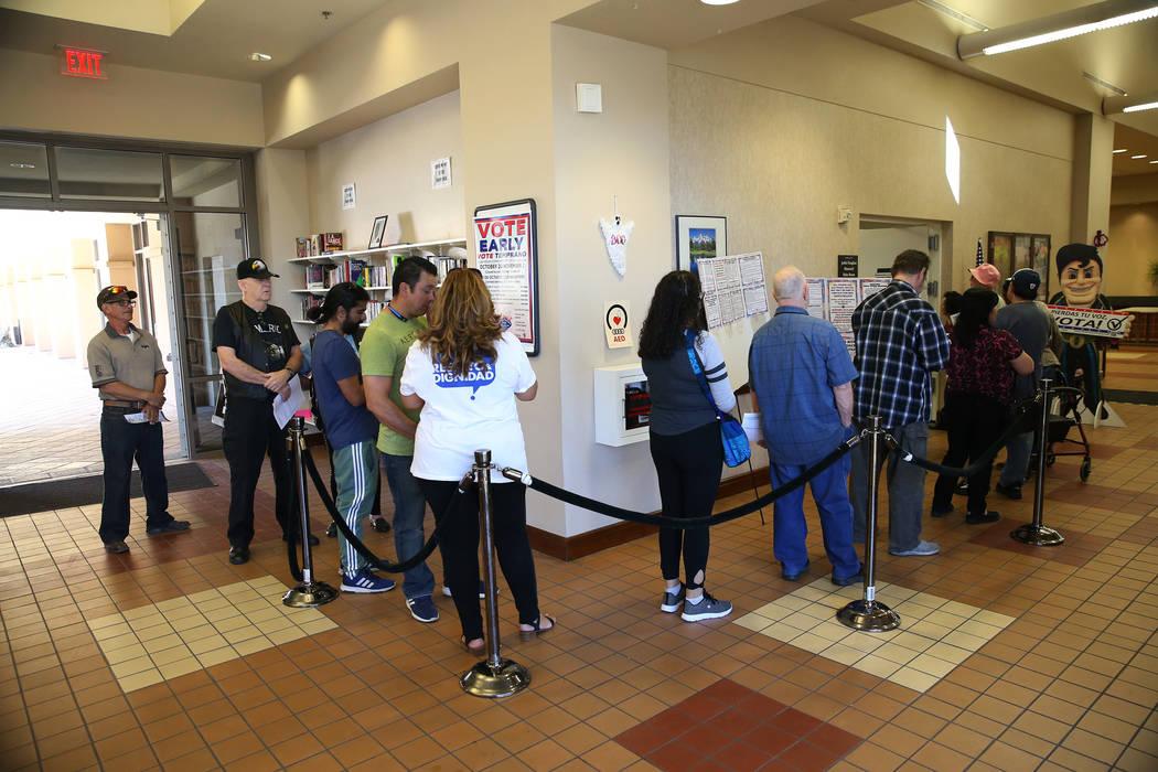 People wait in line to vote at the East Las Vegas Community Center in Las Vegas, Saturday, Oct. 20, 2018. Erik Verduzco Las Vegas Review-Journal @Erik_Verduzco