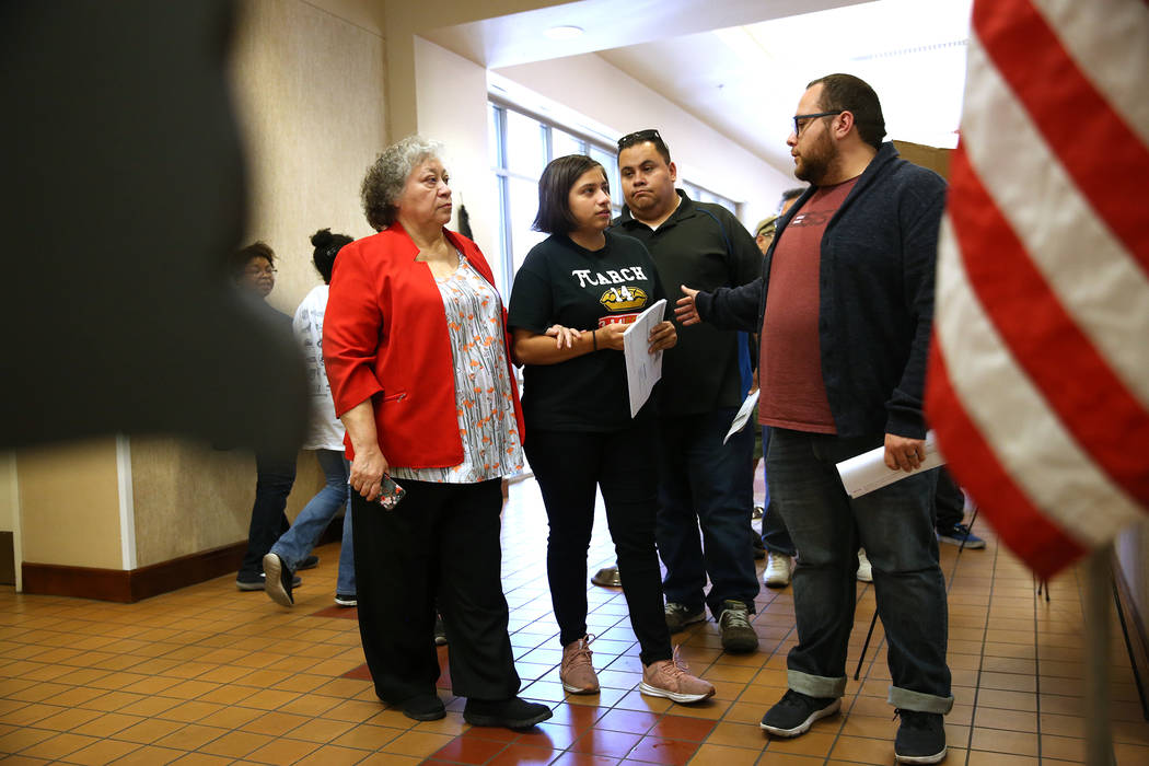 Ana Murrieta, 66, from left, her granddaughter Aremy Tirado, 18, and her sons Leohabin Murrieta, 34, and Leonel Murrieta, 32, wait in line to vote at the East Las Vegas Community Center in Las Veg ...